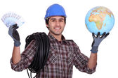 Tradesman getting rich from working abroad — Stock Photo