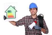 Elektriker stand mit energie-effizienz-poster und megaphon — Stockfoto