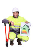 Construction worker with an energy rating symbol — Stock Photo