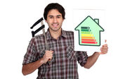 Man holding calipers and information about energy efficiency — Stock Photo