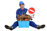 Woodworker sat with box of waste — Stock Photo