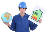 Tradesman with a globe and energy rating sign — Stock Photo
