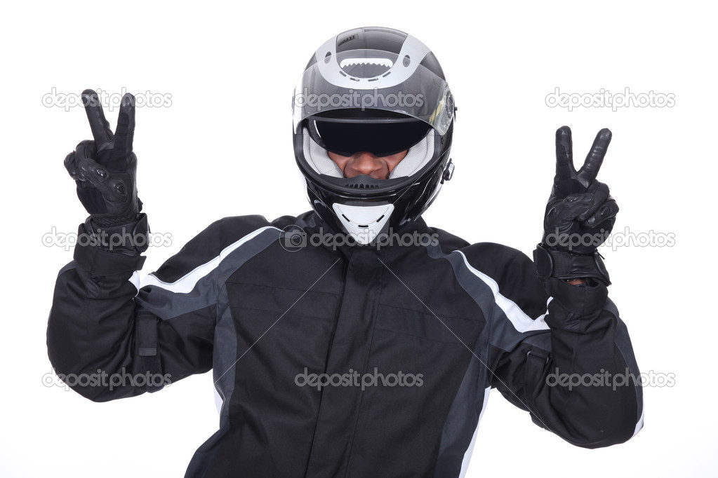 Biker doing victory sign — Stock Photo #10378163