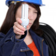Electrician holding a compact fluorescent lamp — Stock Photo