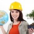 Stock Photo: Worker planting trees abroad