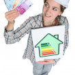 Stock Photo: Portrait of cute female heating engineer holding bank notes