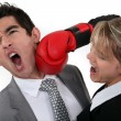 Woman punching her hard-headed colleague — Stock Photo #10381960