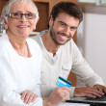 Help senior to buy online — Stock Photo #10383300