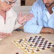 Senior woman playing chess — Stock Photo