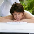Woman receiving a massage at a day spa — Stock Photo #10383838
