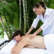 Stock Photo: Womreceiving soothing back massage
