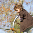 Little girl playing on climbing frame — Stock Photo