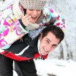 Couple playing in the snow — Stock Photo #10385699