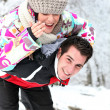 Couple playing in the snow — Stock Photo