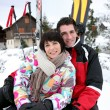 Couple on a skiing holiday — Stock Photo