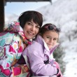Little girl and mother at their ski cottage — Stock Photo