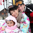 Young family on skiing holiday — Stock Photo