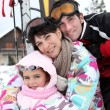 Stock Photo: Young family on skiing holiday