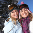 Two women enjoying their skiing holiday — Stock Photo