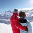 Middle-aged couple stood on secluded snowy mountain — Stock Photo #10385864