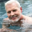 Grey-haired man swimming in the pool — Stock Photo #10385972