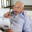 Retiree playing crosswords — Stock Photo