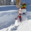Snowman on a mountain - Stock Photo