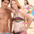 Teenage couple on the beach - Stock Photo