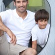 Child camping with his father — Stock Photo