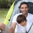 Father and son camping - Stock Photo