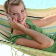 Teen in a hammock with cellphone — Stock Photo #10387616