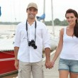 Couple walking along a pontoon — Stock Photo #10387705