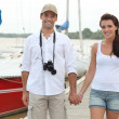 Stock Photo: Couple walking along pontoon