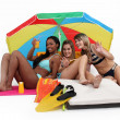 Three women having a great time at the beach — Stock Photo