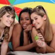 Young women enjoying a day at the beach together - Stock Photo