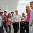 Group of students and teacher stood in corridor — Stock Photo