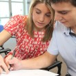 Teacher helping a student — Stock Photo