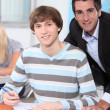Teacher behind student — Stock Photo #10388985