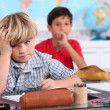 Child in school bored — Stock Photo