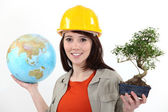 Worker planting trees abroad — Stock Photo