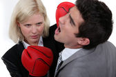 Woman executive punching her colleague. — Stock Photo