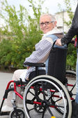 Elderly woman in wheelchair — Stock Photo
