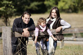 Family strolling in the countryside — Stock Photo