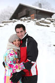 Portrait of young couple at ski resort — Stock Photo