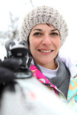 Portrait of woman in snow — Stock Photo