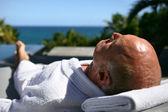 Senior man having sunbath — Stock Photo