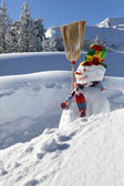Snowman on a mountain — Stock Photo