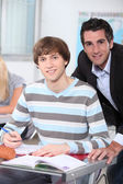 Teacher behind student — Stock Photo