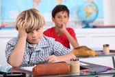 Child in school bored — Stock Photo