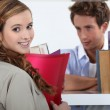 Couple flirting in a library — Stock Photo